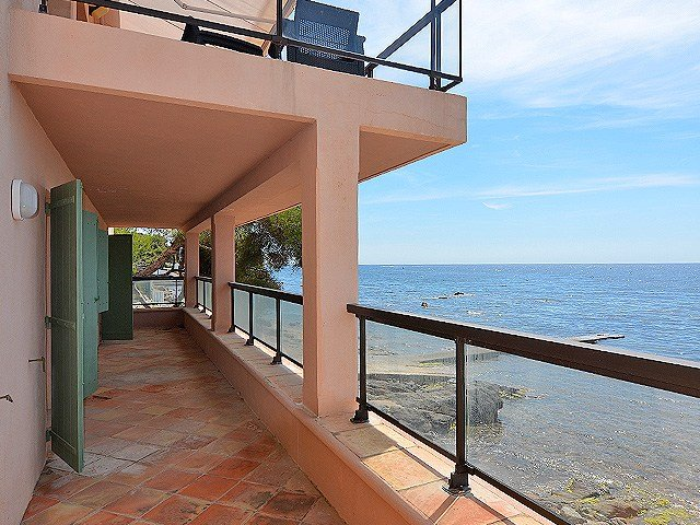 """""""First come, first served"""", therefore, this seafront villa stands in the best possible place, on the beach with the sea at your feet."""