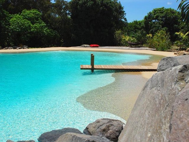 Exclusive outdoor swimming pool in the shape of a lagoon
